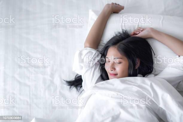 Beautiful young pretty asian woman wake up and make happy smile with picture id1070903684?b=1&k=6&m=1070903684&s=612x612&h=sgyctbuc9upfe3ltvjpro0s9kolz5p6p2qtu grhblu=