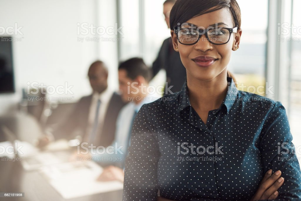 Beautiful young professional woman in office stock photo