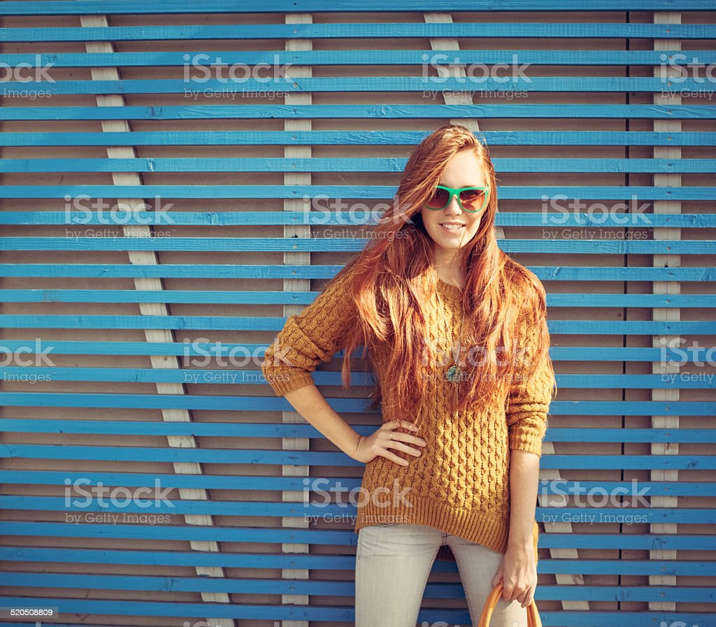 Beautiful young red-haired young girl in sunglasses stock photo