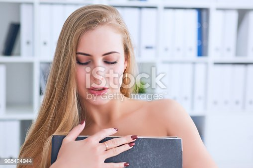 Beautiful Young Secretary Hides Her Nakedness For A Folder On An Office Background Harassment Concept Stock Photo & More Pictures of Adult