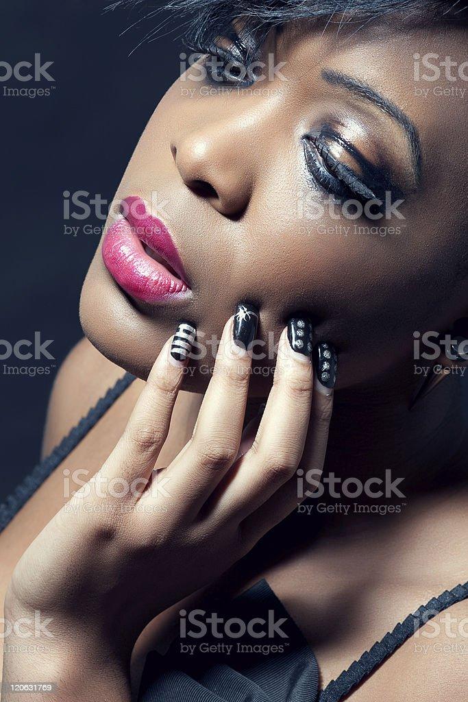 Beautiful young sensual woman with dark makeup stock photo