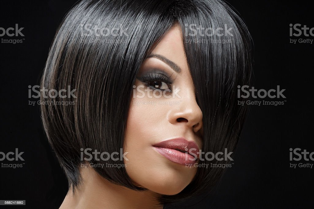 Beautiful young short haired coloured female posing in studio stock photo
