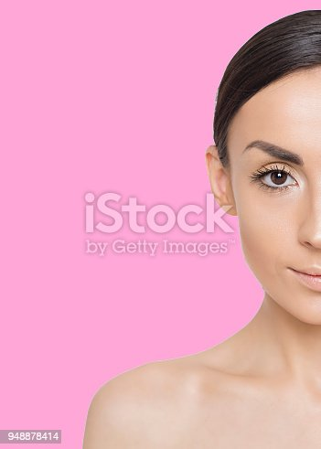 897056188 istock photo Beautiful young smiling woman on colorful background 948878414