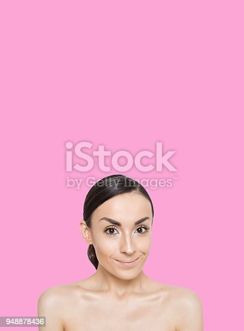 897056188 istock photo Beautiful young smiling woman on colorful background 948878436