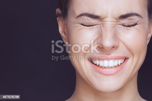 Beautiful Young Smiling Woman With Visible Wrinkles Around