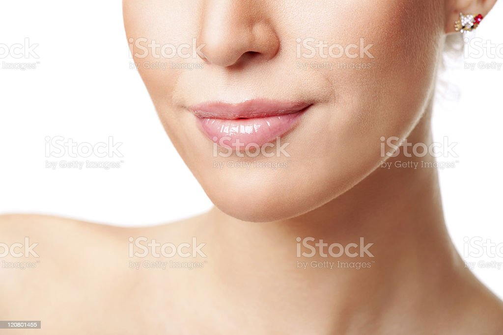 Beautiful young smiling woman's face fragment. stock photo
