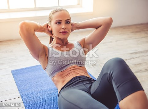 istock Beautiful young sports lady 620743162