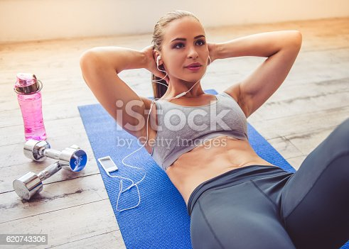 istock Beautiful young sports lady 620743306
