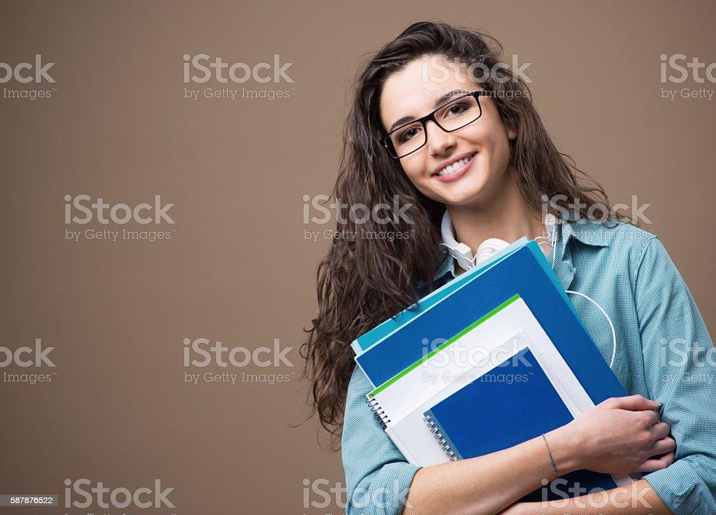 Beautiful young student posing stock photo