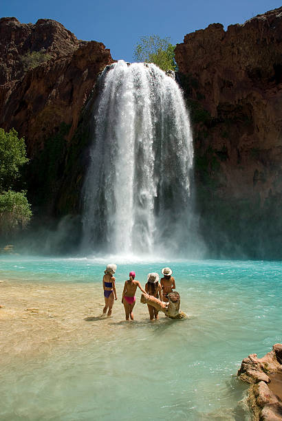 Beautiful Young Swimsuit Models in front of Havasu Falls stock photo