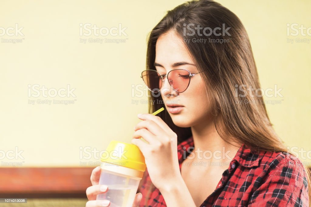 Beautiful young teenage girl with sunglasses stock photo