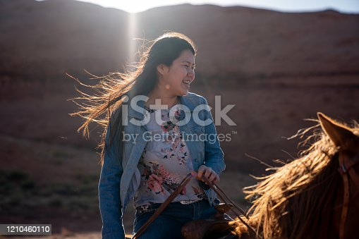 Beautiful Young Teenage Navajo Native American Girl on Her Horse In the Northern Arizona Monument Valley Area