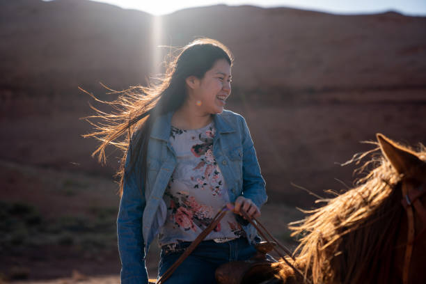 Beautiful Young Teenage Navajo Native American Girl on Her Horse In the Northern Arizona Monument Valley Area stock photo
