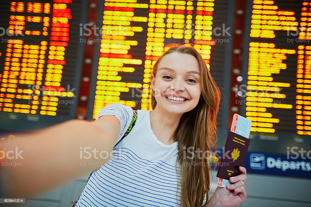 Beautiful young tourist girl in international airport stock photo