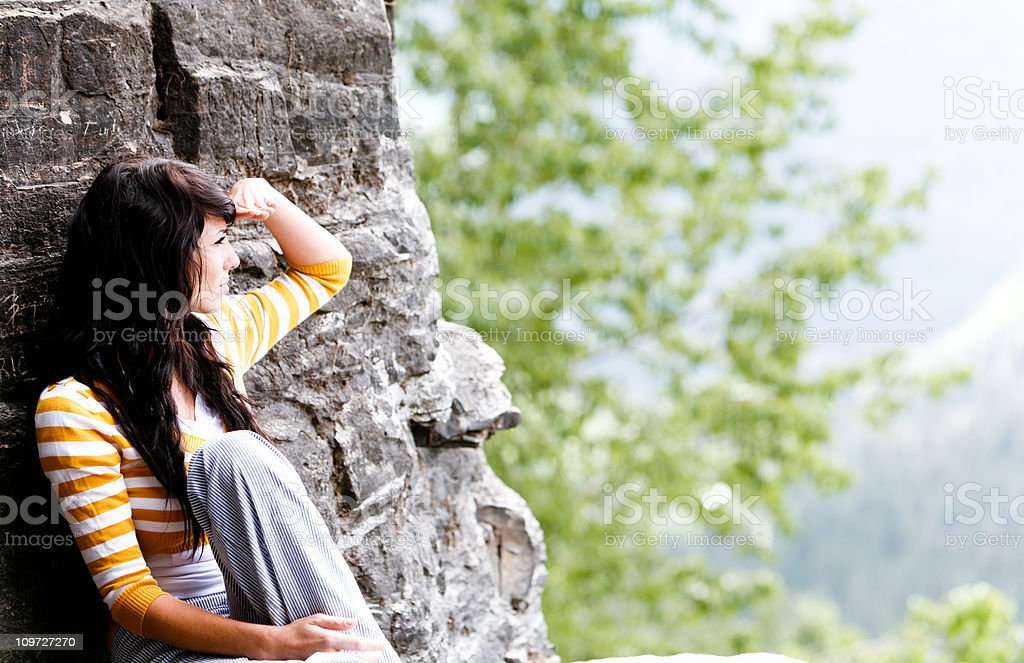 Beautiful Young woman admiring the view in Glacier National Park royalty-free stock photo