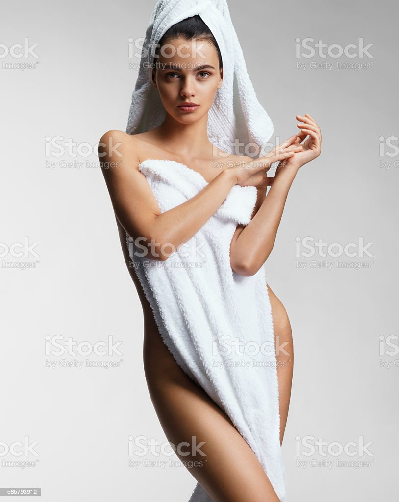 Beautiful young woman after bath with towel. stock photo