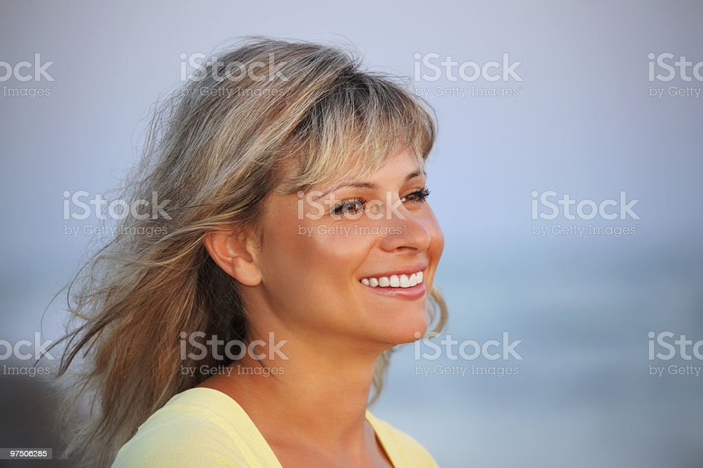 Beautiful young woman against sea, Looking afar royalty-free stock photo