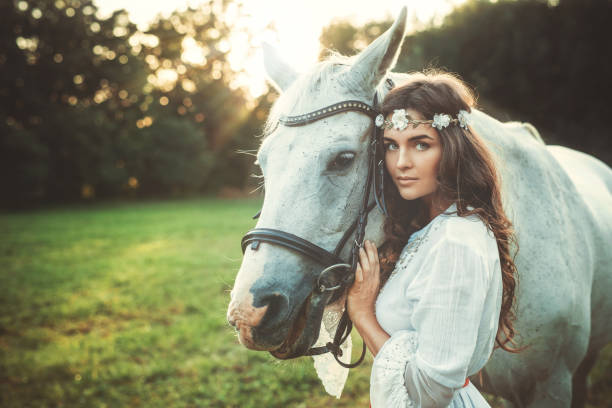 Beautiful young woman and horse stock photo