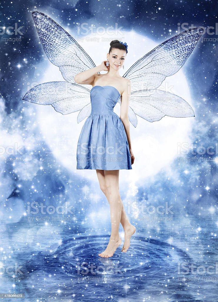 Beautiful young woman as blue fairy stock photo