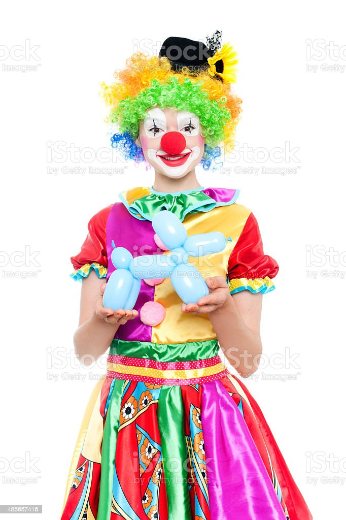 Beautiful young woman as colorful clown stock photo
