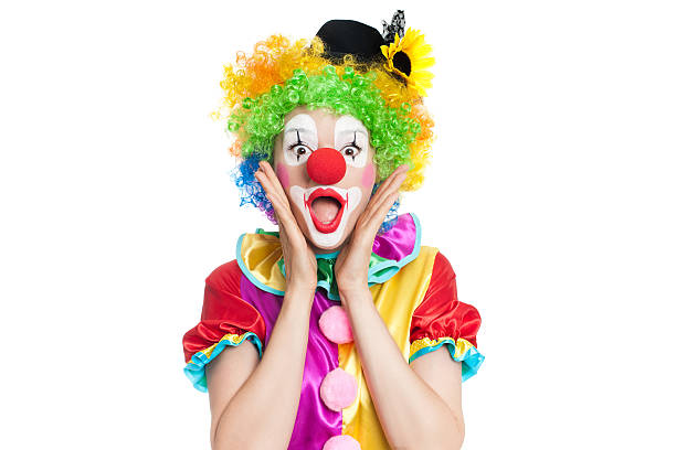 Beautiful young woman as colorful clown Beautiful young woman as funny clown with balloon dog- colorful portrait carnival children stock pictures, royalty-free photos & images