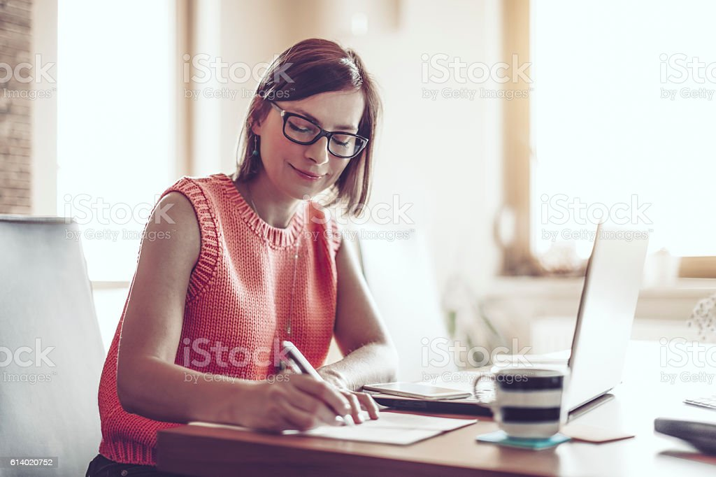 Beautiful young woman at home stock photo