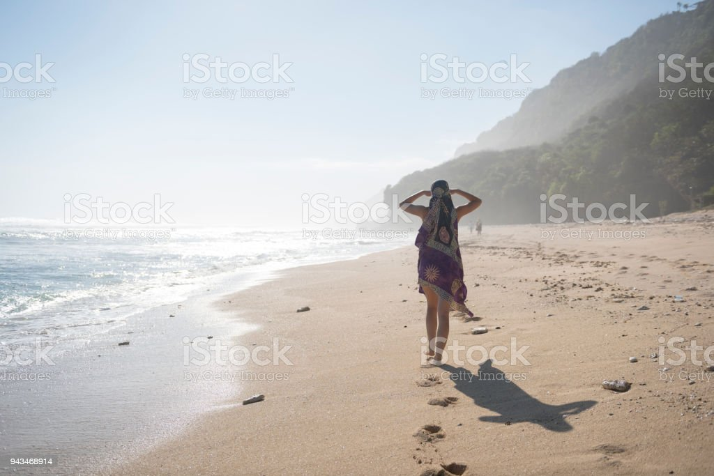 a03e4bdb80 Beautiful Young Woman At Nunggalan Beach On Bali Stock Photo & More ...