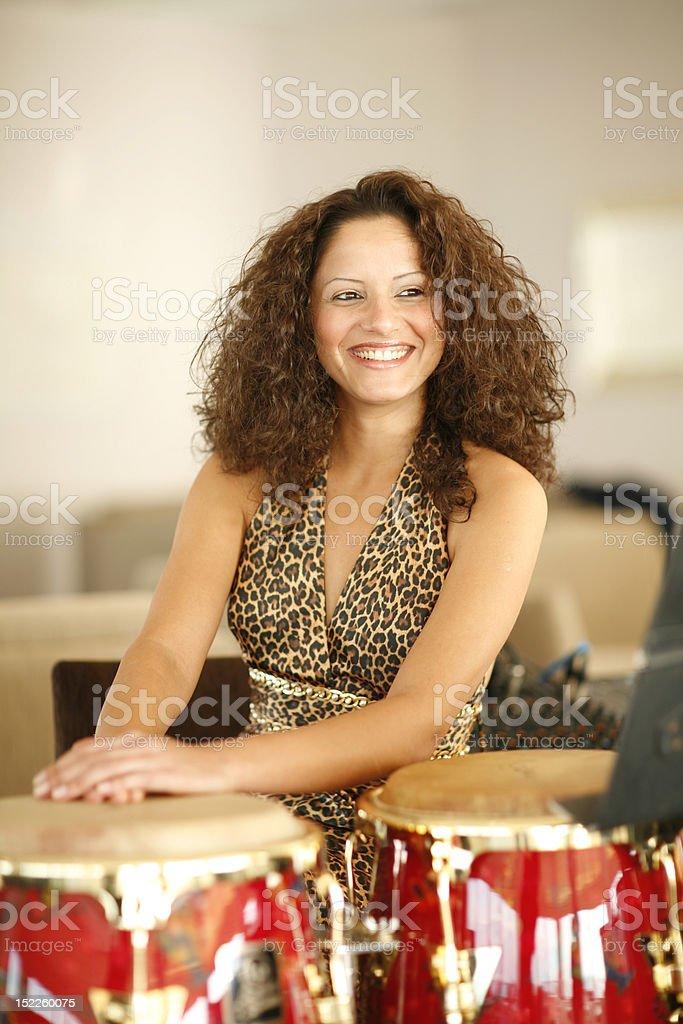 Beautiful young woman at percussion stock photo
