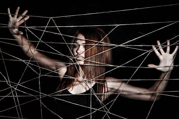 beautiful young woman behind the interlaced ropes - leinenhosen frauen stock-fotos und bilder