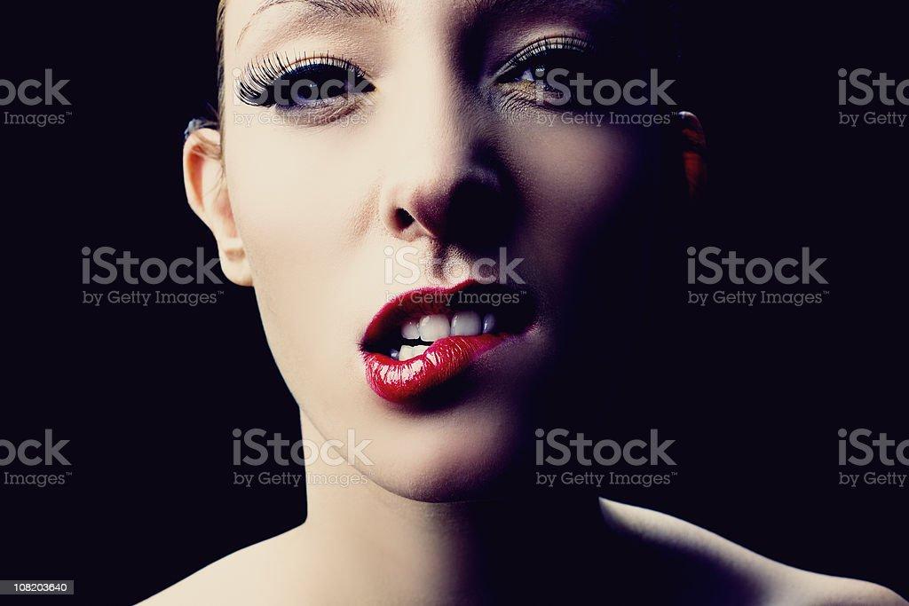 Beautiful young woman biting bottom lip royalty-free stock photo