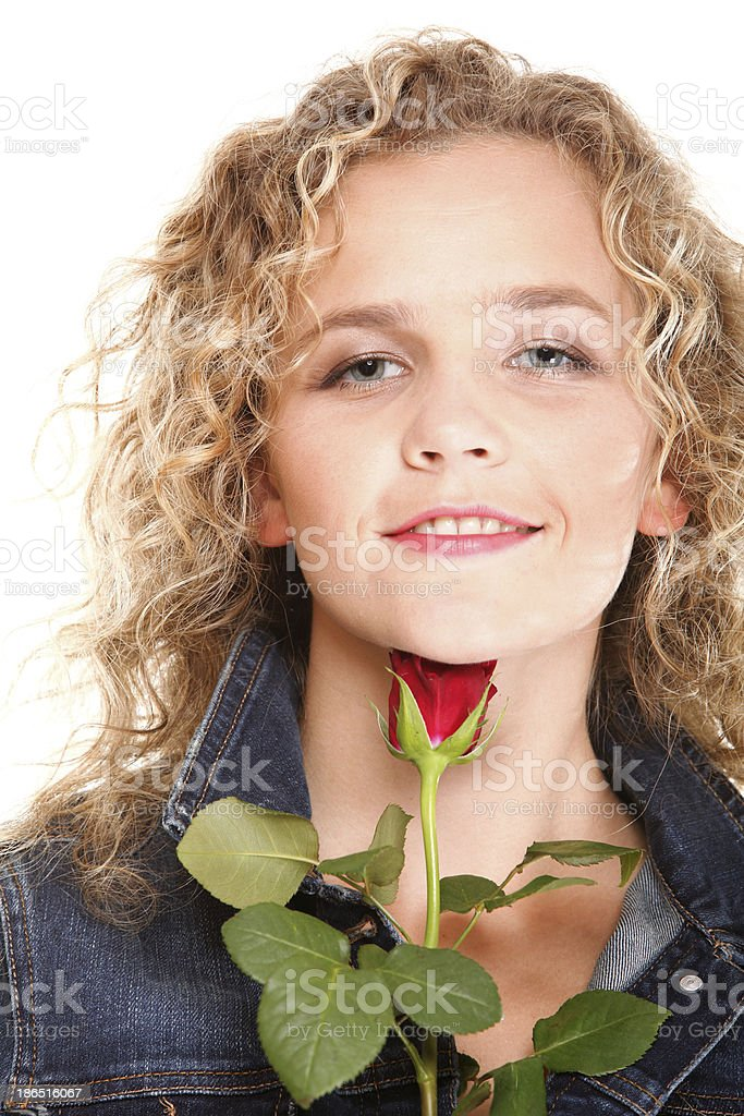 Beautiful young woman blonde in portrait romantic red rose isola royalty-free stock photo