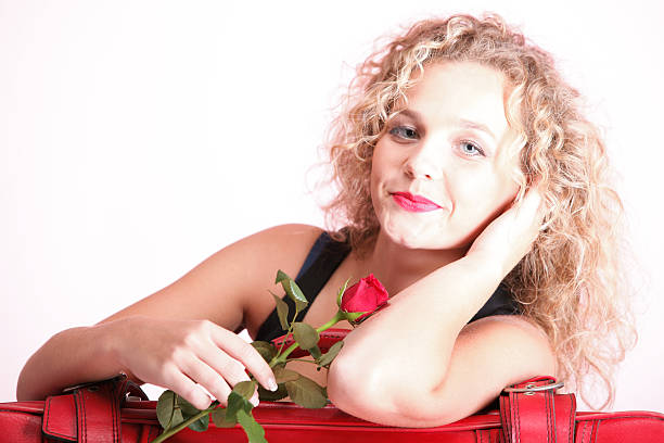 Beautiful young woman blonde romantic red rose stock photo