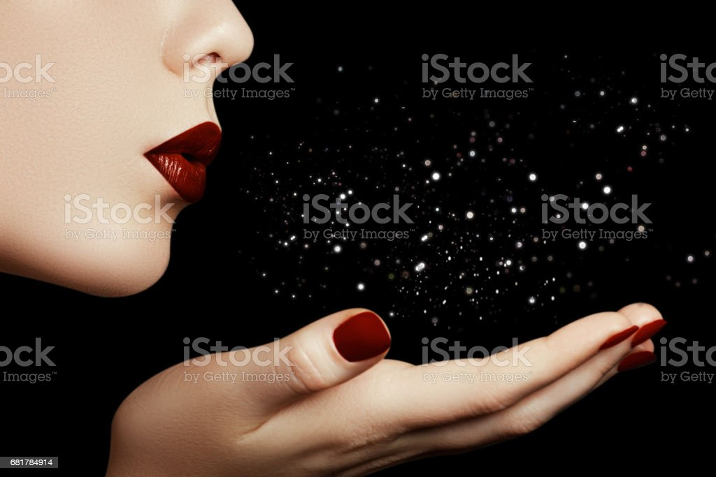 Beautiful young woman blowing a kiss from her hand. Model with p stock photo