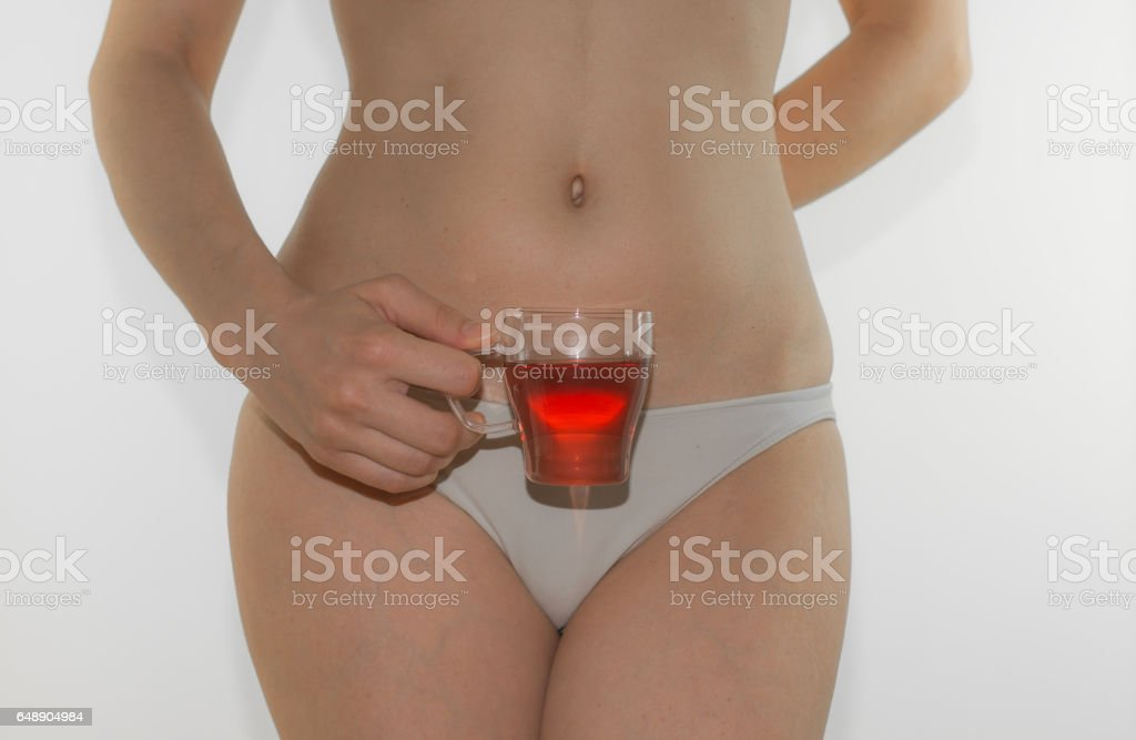 Beautiful young woman body with herbal tea cup stock photo