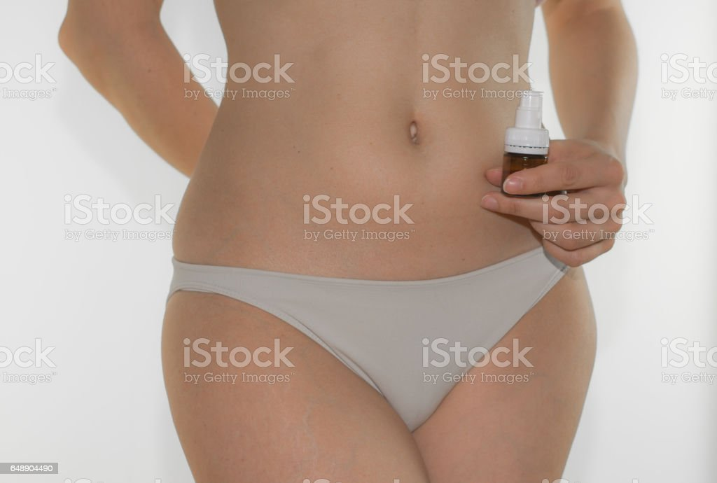 Beautiful young woman body with lactobacilli stock photo