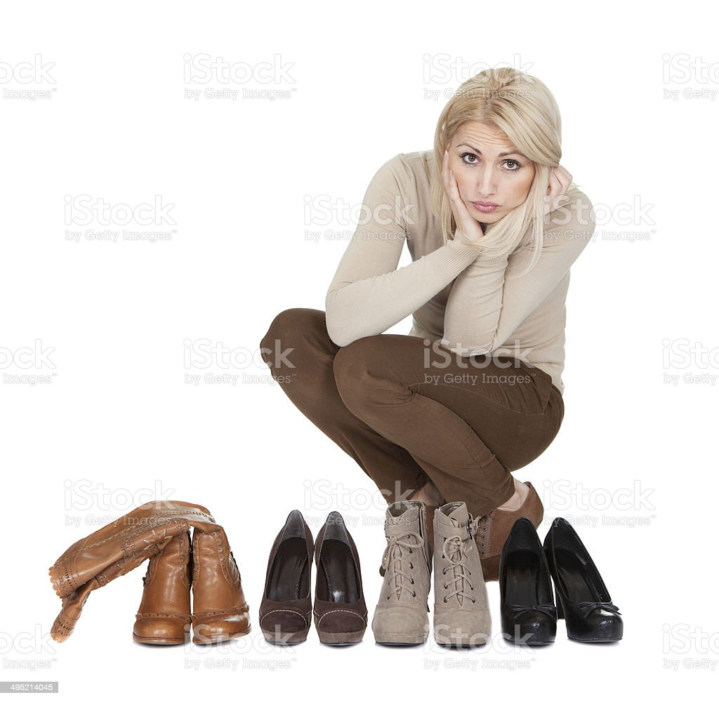 Beautiful young woman choosing shoes to wear royalty-free stock photo
