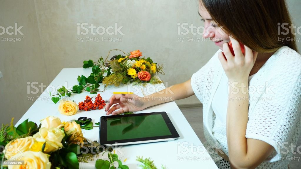 Beautiful young woman color designer talking to customer on  ce stock photo