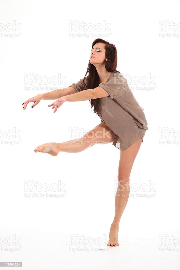 Beautiful young woman concentrates on dance moves royalty-free stock photo