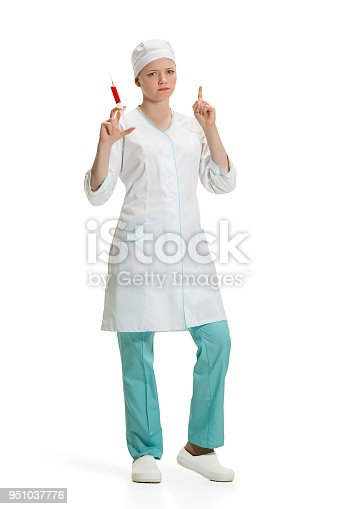 istock beautiful young woman doctor in medical robe holding syringe in hand 951037776