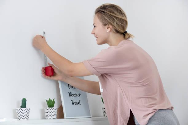 Beautiful young woman doing an unorthodox House Work stock photo