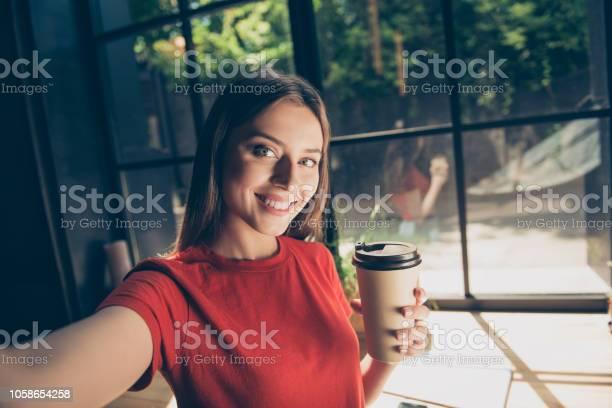 Beautiful young woman doing selfie on the front camera of her and a picture id1058654258?b=1&k=6&m=1058654258&s=612x612&h=jexkrtklhbwnv2gibw0gvj9mqtb6qyqswxiu osc4es=