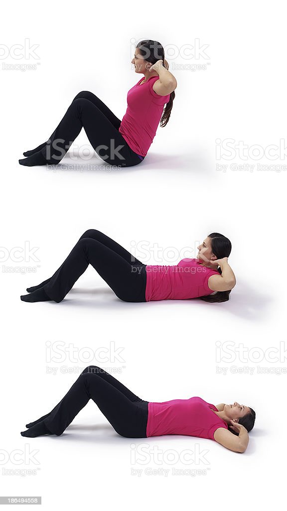 beautiful young woman doing sit-ups royalty-free stock photo
