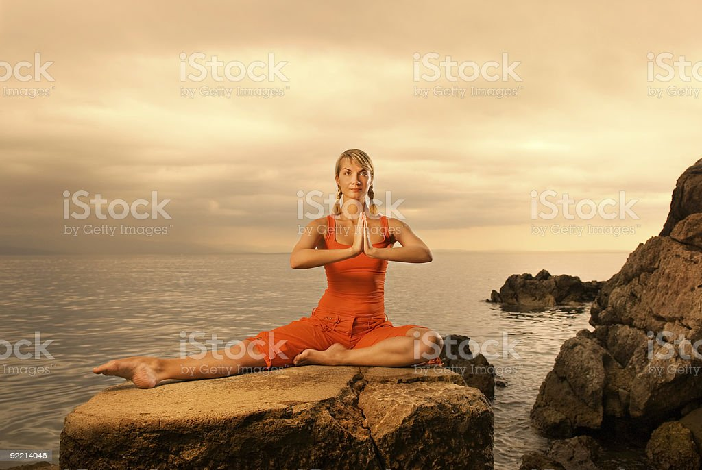 Beautiful young woman doing yoga exercise outdoors royalty-free stock photo