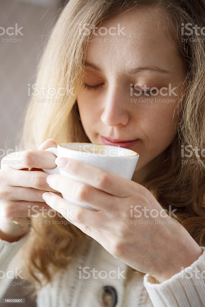 Beautiful young woman drinking coffee. Cup of hot beverage royalty-free stock photo