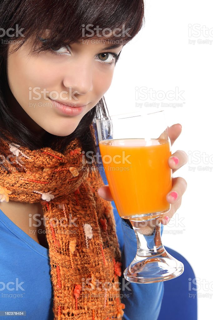 Beautiful young woman drinking juice royalty-free stock photo