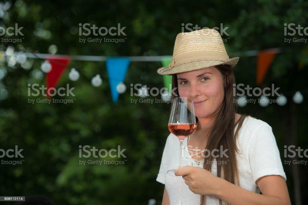 Beautiful Young Woman Drinking Rose Wine stock photo