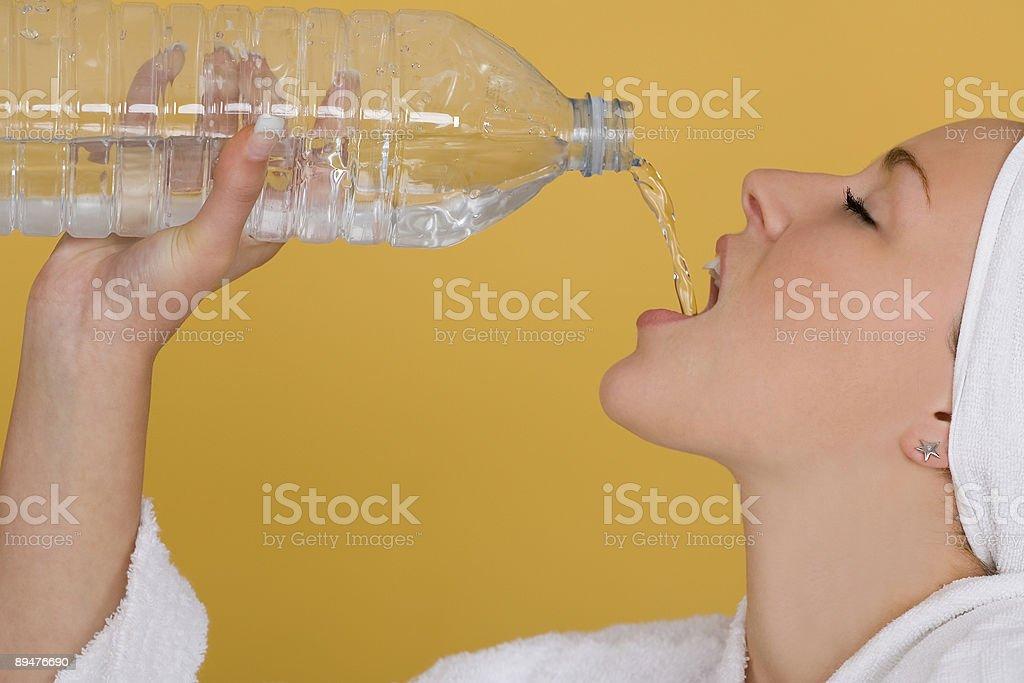 Beautiful Young Woman Drinking Water at Health spa royalty-free stock photo