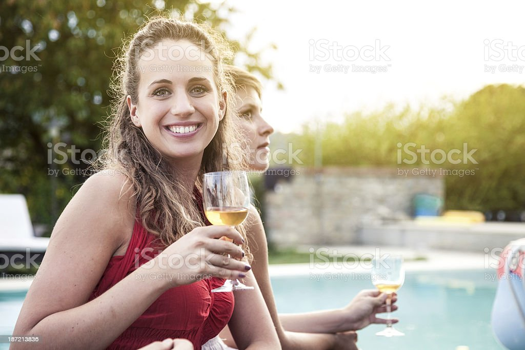 Beautiful young woman drinking wine royalty-free stock photo