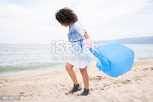 962184460 istock photo Beautiful young woman during local clean up 962182272