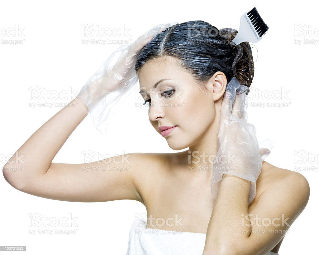 beautiful young woman dyeing hairs stock photo